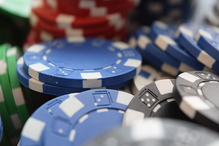 Piles of multicoloured casino chips can be earned with a 200% deposit bonus code