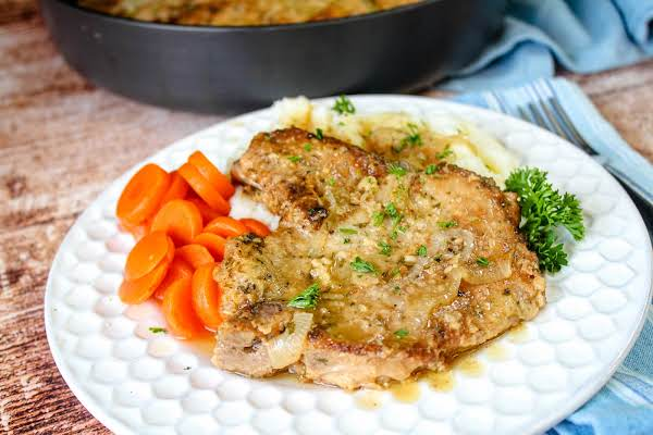 Mom's Tender And Juicy Pork Chops On A Plate.