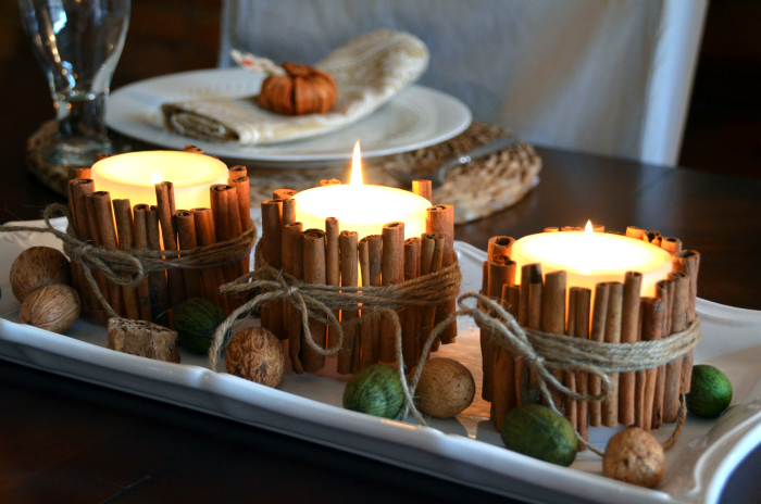 Candles wrapped with cinnamon and twine