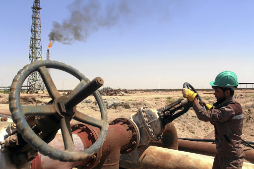 A worker checks the valve of an oil pipe at Al-Sheiba oil refinery in the southern Iraq city of Basra. Picture: REUTERS