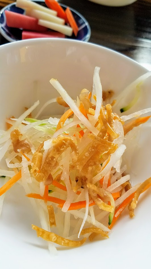 Marukin Ramen side (also available at happy hour) of light shredded daikon salad with ume plum vinaigrette