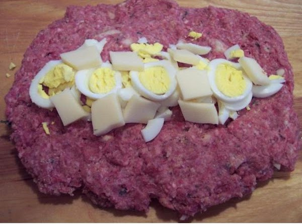 - Place the sliced eggs and sliced cheese on top.
