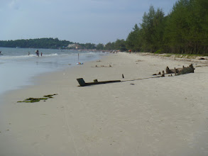Photo: boat buried on the beach