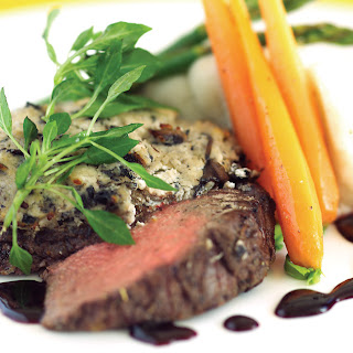 Beef Tenderloin with Goat Cheese-Wild Mushroom Crust, Shallot Infused Balsamic, Black Currant Reduction