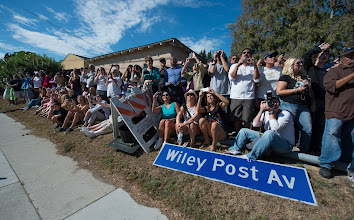 Photo: Spectators are seen as they watch space shuttle Endeavour as it passes by on its way to its new home at the California Science Center in Los Angeles, Friday, Oct. 12, 2012.  Endeavour, built as a replacement for space shuttle Challenger, completed 25 missions, spent 299 days in orbit, and orbited Earth 4,671 times while traveling 122,883,151 miles. Beginning Oct. 30, the shuttle will be on display in the CSC's Samuel Oschin Space Shuttle Endeavour Display Pavilion, embarking on its new mission to commemorate past achievements in space and educate and inspire future generations of explorers. Photo Credit: (NASA/Carla Cioffi)