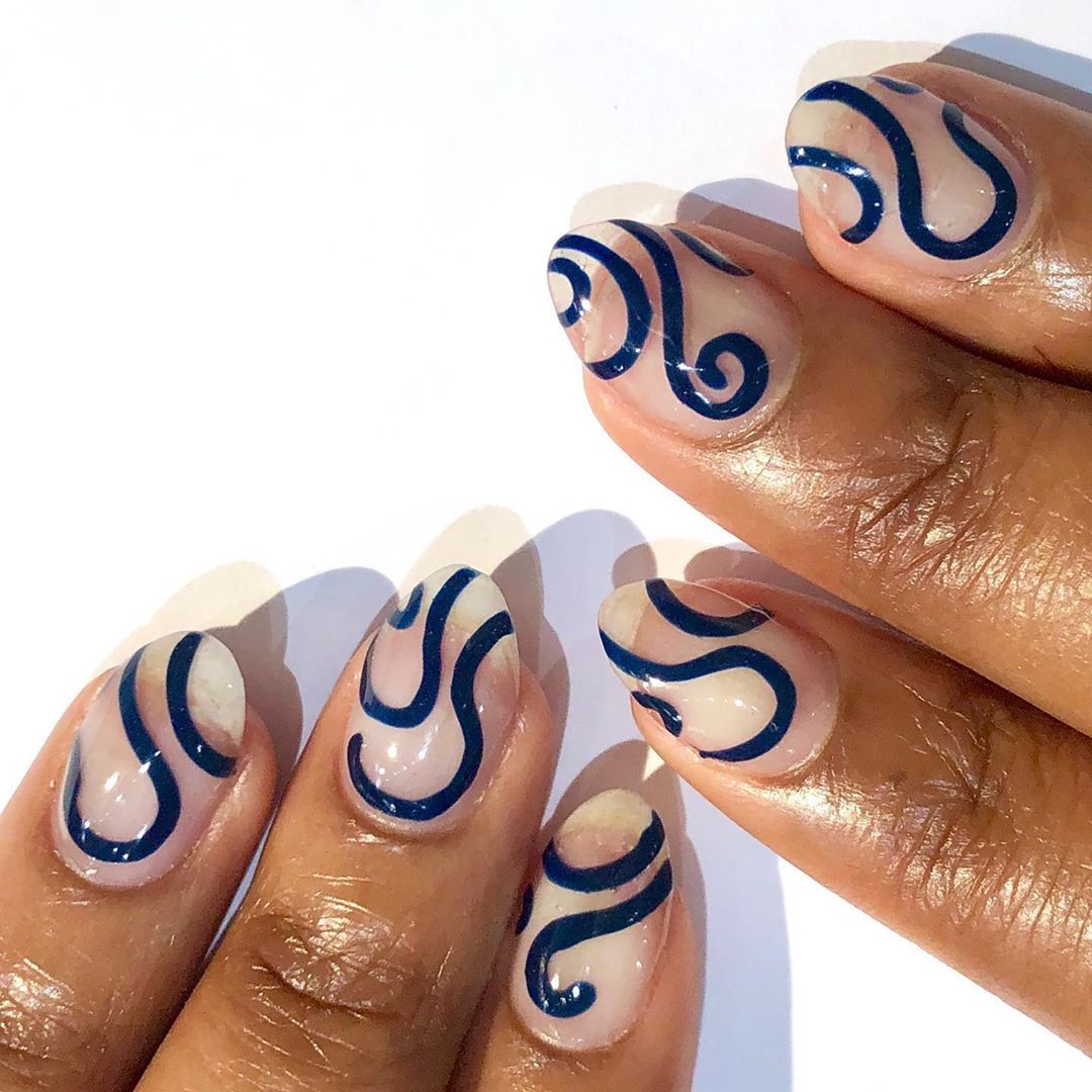 clear nails with navy swirls