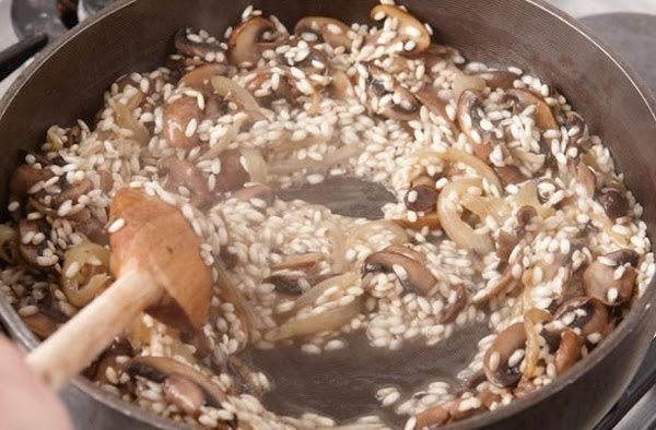 After about 2 1/2 cups of base has been absorbed into the Arborio rice...