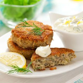 Dijon Salmon Cakes and Arugula with Lemon-Caper Oil.
