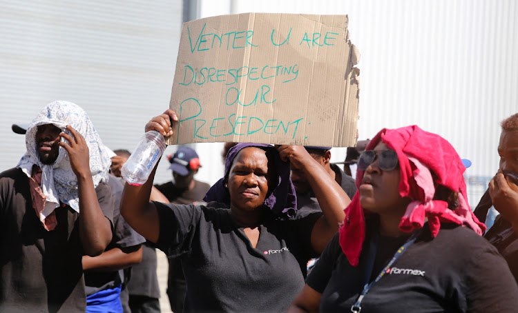 Employees of Formex Industries in Markman Township protest over a pay cut due to the national shutdown