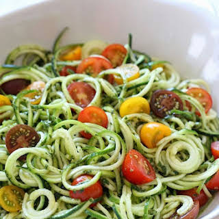Raw Spiralized Zucchini Noodles with Tomatoes and Pesto.