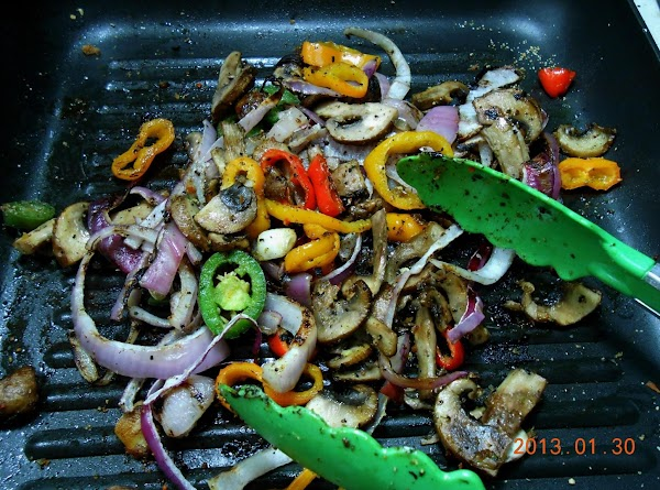 I sliced the mini peppers, jalapeno, onion and mushrooms and drizzled with with a...