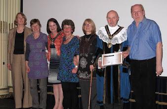 Photo: Staff of Mushroom Bookshop (1972-2000) receive an award