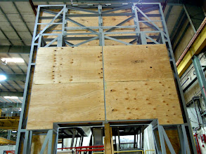 Photo: Lincoln entry portal framework with plywood substrate being applied in preparation for the ACM panels.