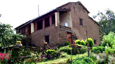 Photo: A hundred year old stone house built by Captain Burathoki now serves as the office and staff quarters