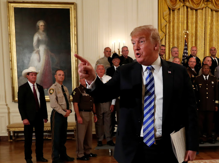 US President Donald Trump addresses the media during a meeting with sheriffs from across the country at the White House in Washington, US, September 5, 2018.