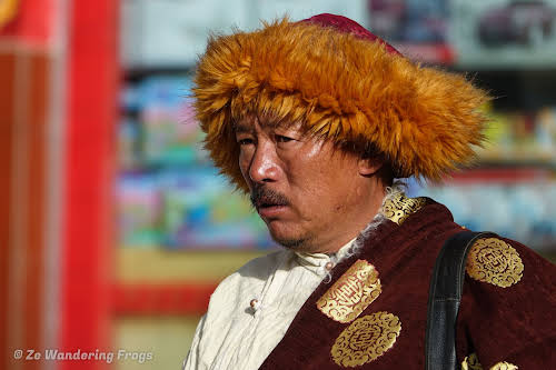 China Sichuan Kham Tibet Garze Ganzi Kandze Monastery Buddhist Festival // A Man Wearing the Traditional Tibetan Furred Robe: Left Shoulder Covered, Right Shoulder Exposed