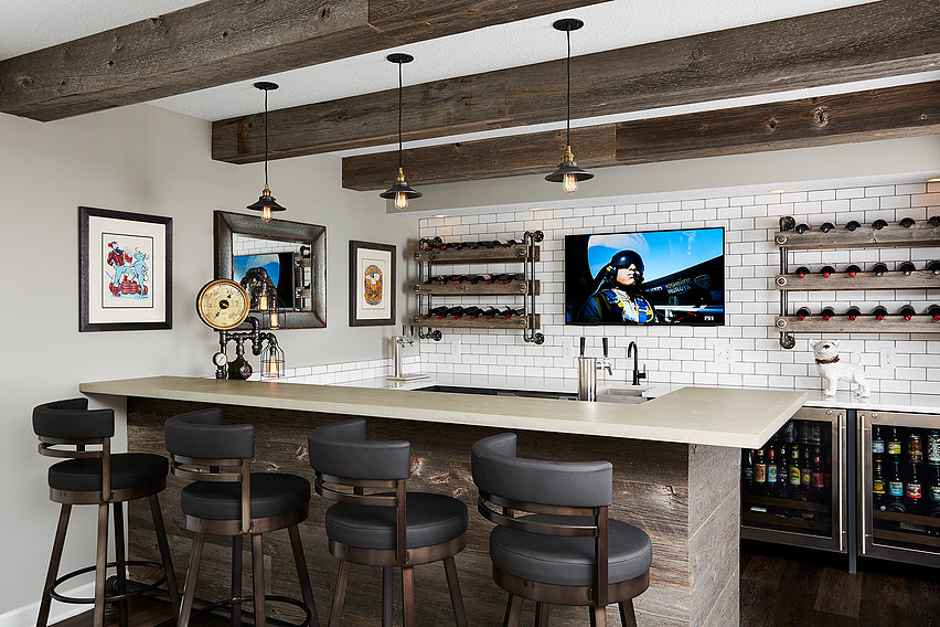 contemporary bar with mixed materials of wood, subway tile and neutral color palette. features open shelving and two drink fridges