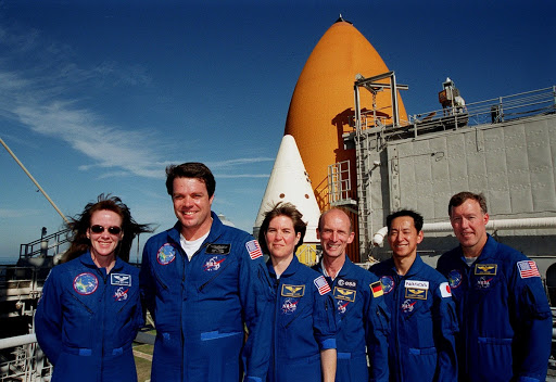 The STS-99 crew pose for a photograph during Terminal Countdown Demonstration Test TCDT activities.