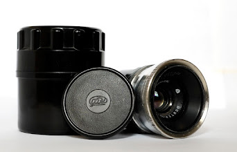Photo: Front of Jupiter 12 lens with lens cap and Bakelite case