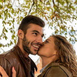 Young couple showing the moments of love by Vera Arsic - People Couples ( young women, romance, two people, friendship, heterosexual couple, city life, togetherness, young adult, kissing, embracing, model, hugging, smiling, attractive, tree, lovers, lifestyles, girlfriend, enjoyment, color image, love - emotion, adult, photography, handsome, couple - relationship, city, 20-29 years, boyfriend, casual clothing, affectionate, modern, romantic, happiness, joy, dating, flirting, caucasian ethnicity, public park, nature, carefree, sexy, intimate, young men, people, standing, young couple, outdoors, feelings, fun, fashion )