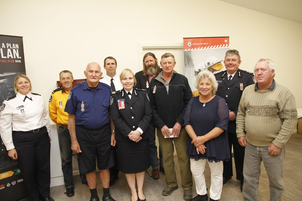 Some of the 31 long service medal award recipients present on Tuesday with RFS visitors, from left, Amanda Brown, (Deep Creek, 13 years service), Tim Baxter (Narrabri, 11 years) Rob Hallett, (Turrawan, 43 years), Greg Cassidy (Narrabri, 13 years), Assistant Commissioner Rebel Talbert, Alex Fawcett (Brooklyn, 36 years), Keith Thomson, Brooklyn, 55 years), Mayor Cathy Redding, RFS regional manager Brett Condie, Grafton, and Ray Stanford (Turrawan 33 years).