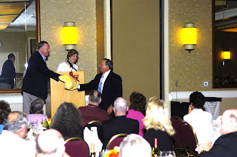 Photo: John Heidtke, who came from South Carolina, receives his award from David and Nancy Montgomery Gilmour