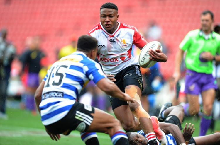 Aphiwe Dyanty of Lions is tackled by Seabelo Sinatla and Damian Willemse of DHL Western Province during the Currie Cup match between Xerox Golden Lions and DHL Western Province at Emirates Airline Park on October 08, 2017 in Johannesburg, South Africa.