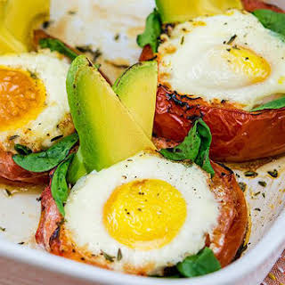Avocado-Baked Eggs in Roasted Tomatoes.