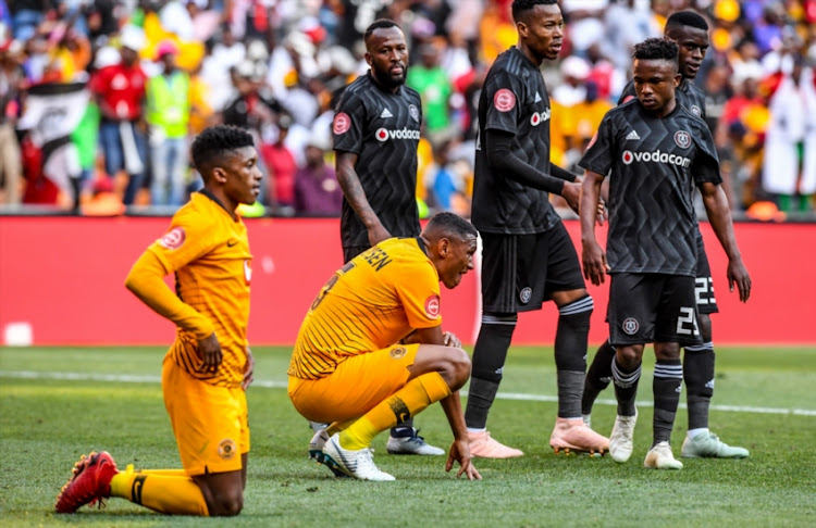 Full time moments as Pirates winning Pirates players jubbillant and Chiefs players dejected. Dumisani Zuma of Kaizer Chiefs and Mario Booysen of Kaizer Chiefs during the Absa Premiership match between Orlando Pirates and Kaizer Chiefs at FNB Stadium on October 27, 2018 in Johannesburg, South Africa.