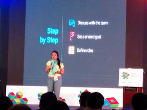 Photo: Putri from GDG Jakarta taking the stage.