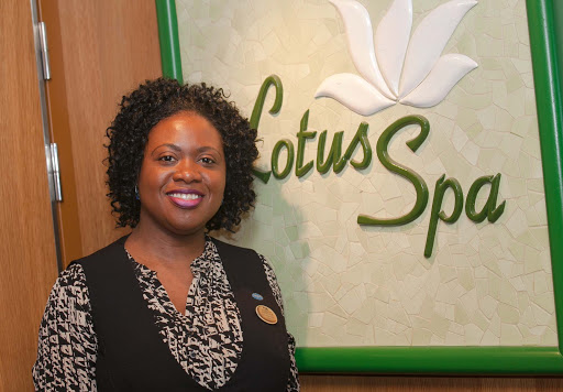 """Aretha Hunter-Morgan, director of the Lotus Spa on Ruby Princess. """"You feel very relaxed after a hot stones massage,"""" she says."""
