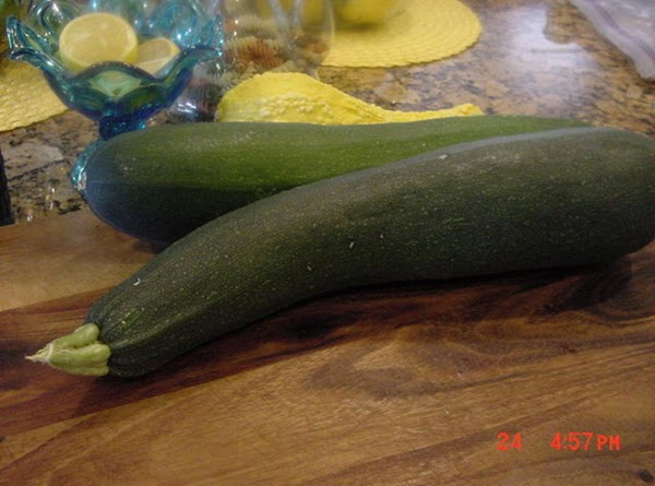 PREPARE THE ZUCHINNI Peel the zuchinni and grate it with a hand grater, and place...