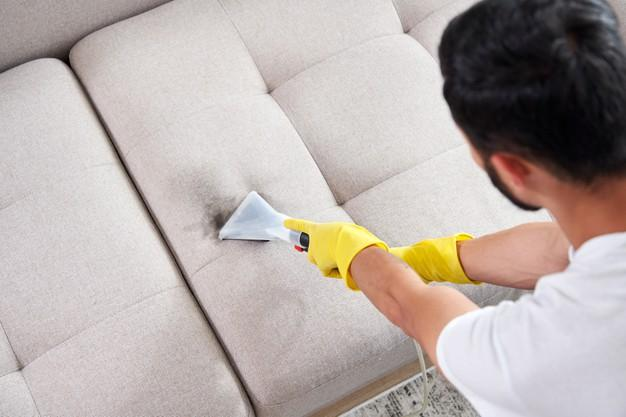 close-up-housekeeper-holding-modern-washing-vacuum-cleaner-cleaning-dirty-sofa-with-professionally-detergent-professional-springclean-home-concept_130111-3702.jpg