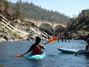 Photo: Erica kayaking upstream from the railroad bridge.