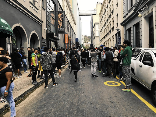 Early on a Saturday in downtown Cape Town, sneaker buyers gather. Among them could be scores of people hired to stack the odds during the lottery-style shoe sale.
