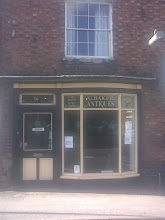 Photo: George Baker Antiques on Boston Road. 2 or 3 nice Grandfather clocks and other choice items available at the time.