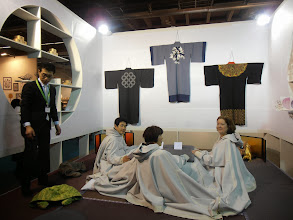 Photo: From the Kori-show project: Kotatsu (a unique piece of Japanese furniture - a frame over the Irori cooking hearth, draped with a quilt to keep friends and family warm. Modern take: These water-repellent parkas are joined and zipped together to cover the upper bodies of those at Kotatsu, and can be unzipped and separated so you can stay in it. www.kaytay.co.jp #ambiente14