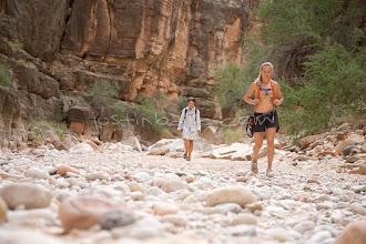 Photo: Two women hiking a side canyon while on a multi day raft trip down the Grand Canyon. Grand Canyon NP, AZ.