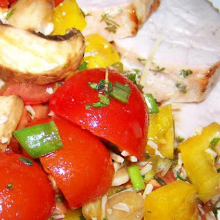 Delectable Roasted Pork Tenderloin With Mushrooms and Tomato Salad.