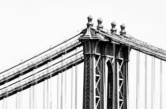 Photo: This shot shows part of the Manhattan Bridge, taken from the Brooklyn Bridge. I took this shot back in April when I was visiting New York with my family. When I took the shot I was thinking that I wanted a high-contrast black and which final image. I've been playing around off an on with this shot trying to get the look that I wanted. I'm still not sure this is quite what I want, but it is coming closer. Certainly happy to hear your comments on this one.