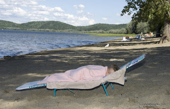 Photo: Three-year-old Shea Howrigan of St. Albans, Vermont, naps after a long day at Sand Bar State Park.  Photo by Karen Pike