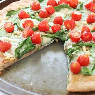 Whole Wheat Spinach, Tomato & Roasted Garlic Pizza.