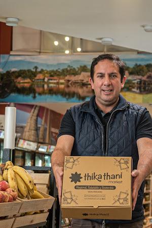 César Vega in the Thika Thani Market