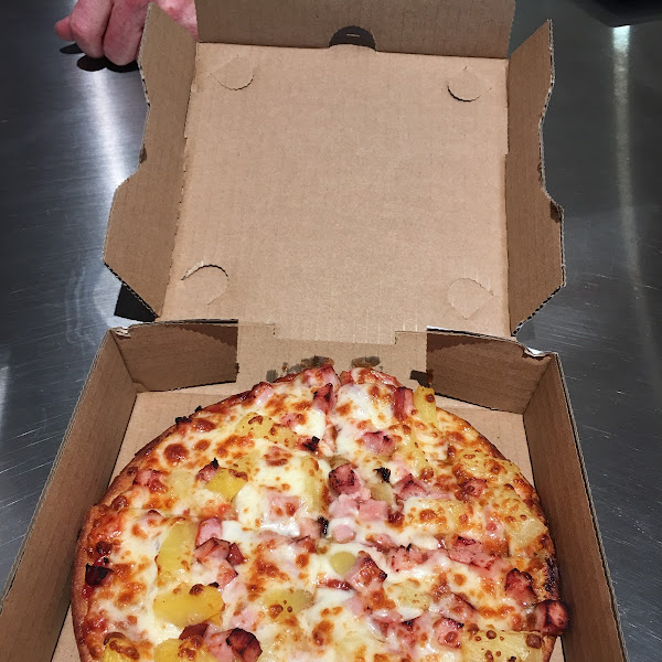 My gluten free Hawaiian style personal pizza (it was the size of my hand if I splay my fingers out) and cost $9.49. It tasted good and came out several minutes before hubby's regular pizza!