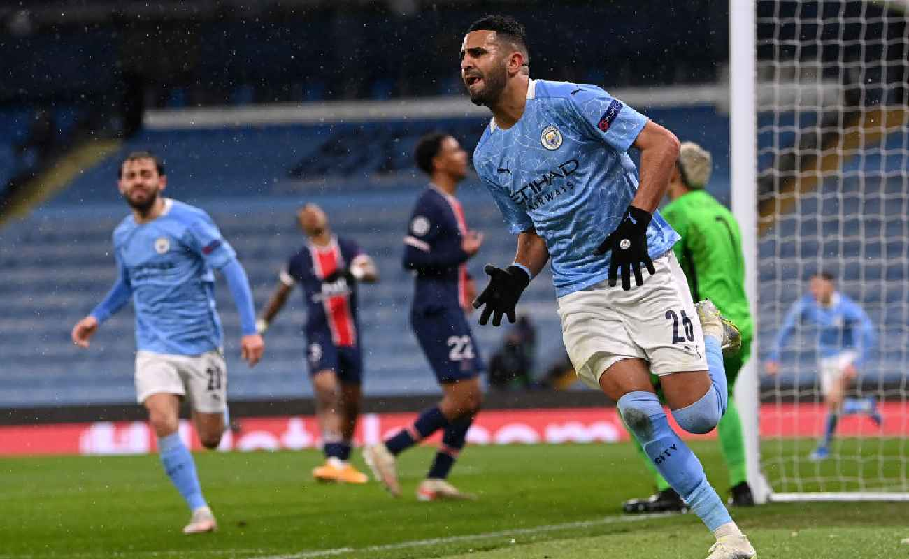 Alt: Riyad Mahrez wheels away in celebration after scoring against PSG - Photo by Laurence Griffiths/Getty Images