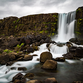Waterfalls In Iceland by Justin Hyder - Landscapes Mountains & Hills ( icelandic, dynjandi, cliff, tourism, scenic, long, summer, rock, westfjords, beautiful, mountain, fall, rocks, white, stream, waterfall, national, power, landmark, flow, park, smooth, sky, falling, green, waterfalls, natural, spray, nature, cascade, iceland, water, stone, outdoor, exposure, outdoors, closeup, background, wilderness, river, travel, landscape )