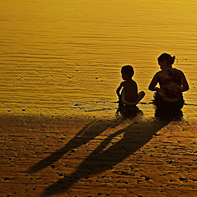 Shadow Of The Day by Bong Flores - People Family ( sand, moment, beach, bonding, mother's day, sun, mom, mother and son )