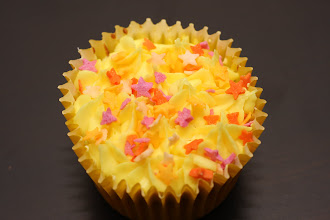 Photo: A lemon cupcake with colourful star sprinkles