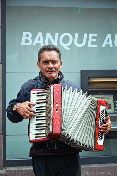 Photo: The Accordion Player  I saw this street performer in Strasbourg, France, two days ago. He was playing outside of a bank for change. I dropped a Euro or two into his case before I snapped a few frames with a 50mm lens. I photographed a few different musicians that day before we went and saw the amazing cathedral.  #100strangers #100strangersproject #streetphotography #portrait
