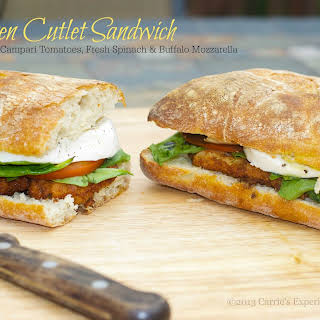 Chicken Cutlet Sandwich with Fresh Spinach, Campari Tomatoes & Buffalo Mozzarella.